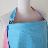turquoise and pink dotted pattern reversible nursing cover
